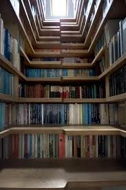 Cool way to store mags and books - combine your stairs with a library!