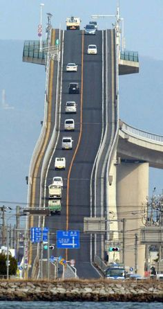 Eshima Ohashi Bridge, Japan The bridge looks more like a roller coaster than a road. The Eshima Ohashi Bridge in Japan rises so. Places To Travel, Places To See, Scary Places, Places Around The World, Around The Worlds, Scary Bridges, Dangerous Roads, Mario Kart, Japan Travel