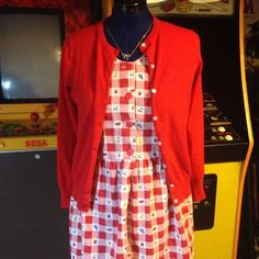 Adorable Vintage Dress in Red Checks with Fruit Super cute vintage 80s-ish cotton sundress, perfect for wearing without shoes to a picnic or, should that seem too on-the-nose for you, maybe throw on a cardigan and hit a late season BBQ! A bit long waisted, but it nips in nicely with a back tie. Two front patch pockets. Oversize front buttons. Size says Petite Large, but it fits more like a regular Large. Hits at the knee. This dress is a charmer, people! Vintage Dresses Midi