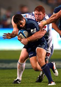 Jackson Willison of the Blues is tackled by Steven Kitshoff of the Stormers during the round 12 Super Rugby match between the Blues and the Stormers at North Harbour Stadium on May 3, 2013 in Auckland, New Zealand.