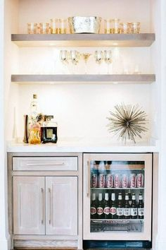 Mini bar nook is filled with gray wash floating shelves suspended over gray wash cabinets fitted with a glass front beverage fridge. Canto Bar, Wet Bars, Bar Areas, Butler Pantry, The Design Files, Floating Shelves, Glass Shelves, Bar Shelves, Open Shelving