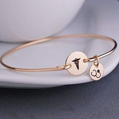 # getting into nursing school Amazing offer on Caduceus Bangle Bracelet Gold Graduation Gift Nurse Stethoscope Charm Medical School Graduation Gift, Nursing School Graduation Gift online - Theveryhotnew Medical Gifts, Nurse Gifts, Nursing School Graduation Gifts, Nurses Week Gifts, Happy Nurses Week, Sneaker Pink, Nurse Jewelry, The Bling Ring, Gold Bangle Bracelet