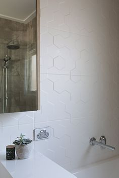 The textured wall tiles are from Beaumont Tiles.