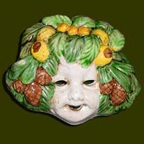 "This collectible Italian ceramic face mask of the seasons Summer ""l'Estate"" is painted in the rich yellows of the Italian summer. We searched far and wide for just the right masks with cherubic faces and rich glazes and we found them at Valentina's in Deruta. Ancient Italians thought these masks brought good luck. Beautiful above a doorway in a kitchen or outdoors on the patio. Hand made in Deruta, Italy.     Size: 6"" mask"