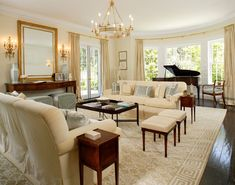 Love this room, especially the mirror and the chandelier.  Cream, gold, and turquoise by Windsor Smith.