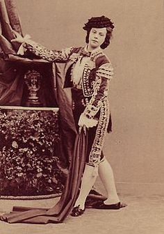 Eugénie Fiocre (b. Paris, 2 July 1845, d. 1908) was a principal dancer at the Paris Opéra 1864–75 where she often danced en travesti, creating Frantz in Coppélia in 1870, and, renowned for her beauty, was sculpted by Jean-Baptiste Carpeaux  and painted by Degas in a scene from Saint-Léon's ballet La Source. She was married to Stanislas Le Compasseur de Créqui-Montfort Marquis de Courtivron and mother of explorer, anthropologist, diplomat and Olympian Georges de Crequi-Montfort.