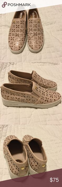 Michael kors Keaton laser-cut slip on sneaker Used Michael kors  Keaton laser cut slip on sneaker . This shoe is in pretty good condition super comfortable and it you love pink this is perfect for you 😊 really soft pink genuine leathers. Feel free to make an offer. Thanks guys and happy listing. KORS Michael Kors Shoes Sneakers