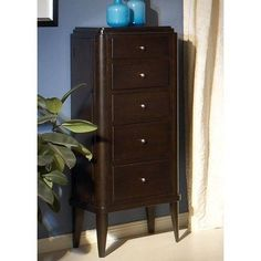Zocalo 1419 Monaco 5 Drawer Lingerie Chest by Zocalo. $689.00. MON-ZC-58 Features: -Stepped, rounded edges.-Brushed nickel, jewel - like knobs.-Felt lining on all drawers.-Three - stage, ball bearing drawer glides.-Two side storage areas with mirrors and hooks. Construction: -Constructed from select hardwood solids and cherry veneers.-Five drawers with dovetail construction. Color/Finish: -Dark Walnut finish. Dimensions: -Overall Lingerie Chest Dimensions: 52'' H x 21'' W x 16'' D.