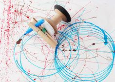 Drawing machine,wind-up toy by All Lovely Stuff.  Teach about elastic potential energy.  Instead of the wax circle, maybe could use washers (clothes pin glued to one, plus another to help spin freely?  Possible science fair project - see how diameter of the circle drawn relates to diameter of the two end cylinders.  Pi day activity?