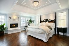 Ranks up there with a near perfect bedroom!  Hardwood floors and a fireplace!