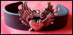 Black Leather Cuff with Winged Heart and Arrow Charm by Lovemades, $19.99