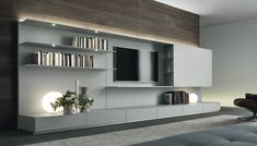 The great room wall the TV will be on could handle something this dramatic, I think. ABACUS MEDIA UNIT by RIMADESIO available at Haute Living
