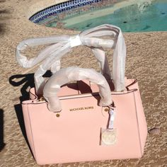 HPLAST CHANCE Michael Kors sm Sutton satchel HP style staples 4/8/16 LAST CHANCE REDUCED Hard to find, Michael Kors  small pastel pink Sutton leather satchel. It's 8 inches high by 11 inches length and 3 1/2 inches deep. On each side of the inside there are two separate top zip pockets. In the center pocket there is a side zip pocket and 4 slip pockets.  Great for organization. Front has Hanging Michael Kors logo. Two handles and an adjustable, removable cross body strap. NWT Price Is Firn…