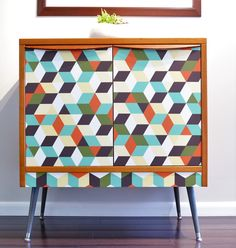 If you are looking to update your furniture, don't rush to throw old things out. Think how you can give them a second life. Here is the example how you can refresh your old furniture with just vinyl wallpaper and some accessories.