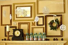 no snowflakes, wreathe or clutter on mantel - LOVE all the same color of frames and various sizes