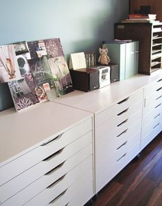 ALEX ikea drawers. I like the 3 lined up along the wall. The machines and paper storage could go on the top.