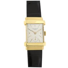 PATEK PHILIPPE & CIE Ref. 1450 'Top Hat'  Switzerland  1950's  Patek Philippe Ref. 1450, 'Top Hat' circa 1950, is one of the most identifiable mid-century Patek watches with its double stepped hooded lugs that lend it the 'top hat' epithet.
