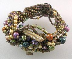 by Paula Huckabay.  This exquisite freeform bracelet.