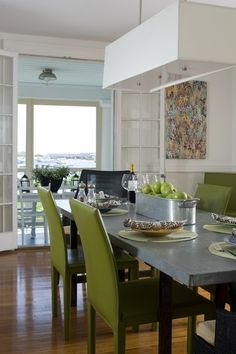 Contemporary Dining Room by Kate Jackson Design. Zinc topped dining table