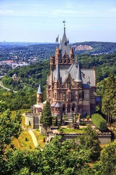 Schloss Drachenburg (Drachenburg Castle),  Königswinter, on the Rhine near Bonn, Germany...    www.castlesandmanorhouses.com   ...    (this is a side view)  Schloss Drachenburg is a private villa in palace style constructed in the late 19th century. It was completed in only two years (1882–84) on the Drachenfels hill. Baron Stephan von Sarter, a broker and banker, planned to live there, but never did. Today the Palace is in the possession of the State Foundation of North Rhine-Westphalia.