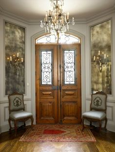 leaded glass doors/transom, antiqued mirror panels, chandeliers dripping with prisms, ...beautifully symmetrical