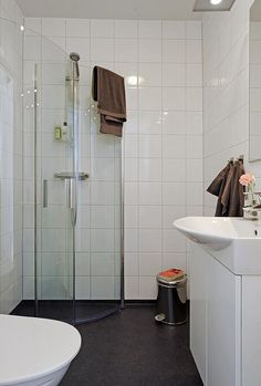 Small Black and White Bathroom Ideas for Design Inspirations with Corner Space Shower Room that have Curved Shaped Glass Wall and Contemporary White Wood Vanity complete with the Sink also Elegant Black Ceramic Materials Flooring Types