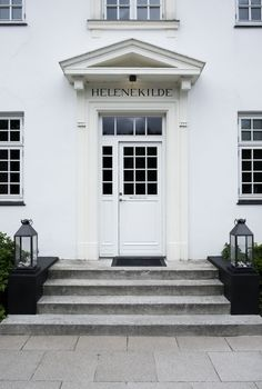 Lanterns from tinekhome surrounds the entrance of Helenekilde Badehotel in Denmark.