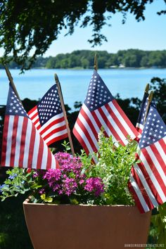 Flags in planter | homeiswheretheboatis.net #tablescape #july4th #LakeNorman