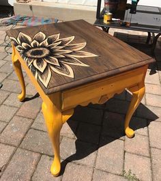 """(From burlap and barn wood on Facebook) """"I use Sharpie Oil-based paint pens and Minwax stain in Ebony to create my paintings. My signature piece, the sunflower end table"""""""