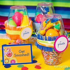 """Send guests home with ¡olé!-pinata party favors! Take 2plastic cups, filling 1 w/colorful crepe streamer confetti & other w/candy fruit & bubble gum. Carefully place candy-filled cup upside-down over the confetti cup so the treats rest on top of the confetti. Wrap where the cups meet w/fringe-cut streamers, curling ribbon & a favor label. Place treats by the door w/a fiesta-colored place card """"TAKE ONE"""""""