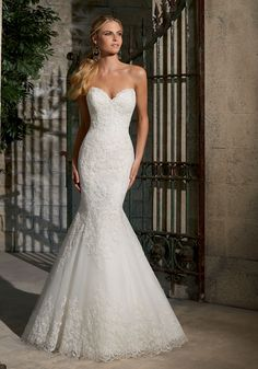 This fine lace mermaid Wedding Dress is classically beautiful. Subtle scalloped edging around the neckline and illusion back. Colors available: White and Ivory.