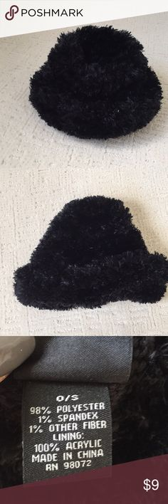 Black hat Black hat in soft and shaggy knit. Accessories Hats