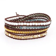 If you love the new trendy, wrap bracelets, you won't want to miss our Chen Rai Multi Stone Wrap Bracelet. This wonderful piece of jewelery has five different stone colors making it a great piece that can be paired with any look. With white, silver, blue, gold and beige beads you can't go wrong with this wrap around bracelet. Our Chen Rai wrapped bracelet measures 38 long and is easily adjustable to fit all. Wrap it as many times as you wish for a rock star look!