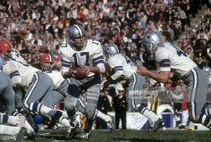 Don Meredith hands off to running back Craig Baynham in this 1967 playoff game at the Cotton Bowl. Dallas destroyed Cleveland 52-14.