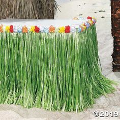 Tropical Flowered Table Skirt Looking for the perfect beach party decoration? This artificial grass table skirt is the essential party supply for a fabulous Hawaiian party! Lined with . Aloha Party, Luau Theme Party, Hawaiian Luau Party, Hawaiian Birthday, Tiki Party, Hawaiin Party Ideas, Lua Party Ideas, Hawaiin Theme Party, Adult Luau Party