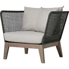 With a beautiful balance of materials, This Netta Patio Chair is a modern take on outdoor lounging. The low profile frame, built in solid Eucalyptus, is a natural moisture repellent. The plush cushions, upholstered in brushed performance fabric, are treated to be exceptionally resistant to the harshest elements. Unlike most outdoor furniture, the Netta features a uniquely-designed armrest and back that's wrapped in resilient regatta roping and crosshatched for an unmistakable aesthetic.