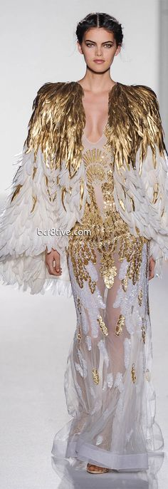 Zuhair Murads Collection of Couture Evening Gowns for Spring Summer 2013 are total glamor. White and Gold dominate and are accented with nudes and an occasional sky blue. These designs are certain to be seen during the next Red Carpet event, the question simply will be who will be seen