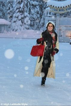 #fashionover50 woman in leather coat, gloves, Russian scarf, polka dot shirt, and leather skirt