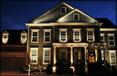 Custom architectural lighting showing several custom second level accents by Outdoor Advantage