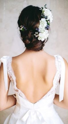 Bridal hair low bun updo with flowers