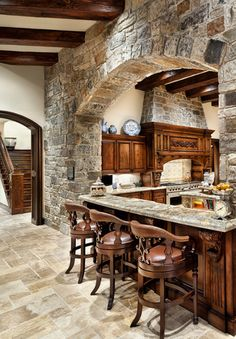 Love the natural textures in this Kitchen...
