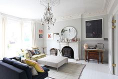 locations | Flickr The painting in hte corner balances the L shaped lounge. creating a rather dynamic space. a touch of yellow and blue always great with white