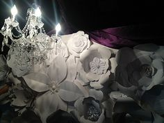 This is a ft wall of Paper flowers inspired by the Chanel fashion show.flowers were created with simple printing paper, cardstock and poster board.the final was amazing so much work .so worth it! Fashion Show Poster, Chanel Fashion Show, Paper Flowers Wedding, Paper Flower Wall, Wedding Stage, Backdrops, Ceiling Lights, Crafty, Artist