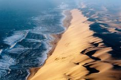 "Namib Desert - The ""Long Wall"", sometimes called ""the Wall of Death"", is a 100m high stretch of sand dune which runs parallel to the Atlantic coast. You can drive along the beach at the base of the wall during low tide. At high tide, all vehicles would be submerged."