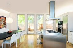 open dining room and kitchen  contemporary kitchen by LineBox Studio