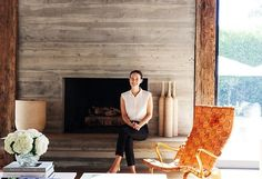 A Look Inside Jenni Kayne's Rustic & Modern California Home.  modern fireplace paired with rustic beams for chez mtn.