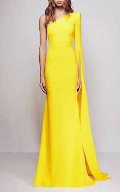 This **Alex Perry** gown features a one-shoulder silhouette and single wide flared sleeve with front slit.