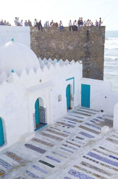 A popular festival of culture has made this small seaside town near Tangier a destination for art-world insiders—without ruining its unhurried pace and traditional way of life. Marrakesh, Tanger Morocco, Voyager C'est Vivre, Morocco Travel, Seaside Towns, Spain And Portugal, Grand Tour, Historical Sites, Casablanca