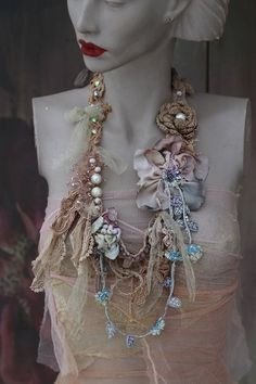 Experimental long necklace in my experimental style in shades of ecru, cream, dusty pale blue and green, pale purple... This shabby chic detailed neckpiece is made of textured and embroidered laces, hand painted silks, sculpted torn silk flowers,, trims and finds. Intuitively hand sewn