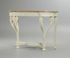 "c1785 PAINTED CONSOLE ""AUX VOLUTES"", Louis XVI, probably G. JACOB (Georges Jacob, maître 1765), Paris ca. 1785. Wood exceptionally finely carved with rosettes, leaves, wave band, beading, paws and ornamental frieze, and painted white. Red/grey speckled marble top. 120x56x96 cm. Sold for CHF 32 000 (hammer price)"